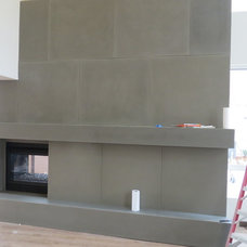 Contemporary Indoor Fireplaces by Concrete Habitat