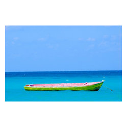 Boat in Negril - Tranquility and light radiates from this photograph by Nina Fuller. The magnificent hues of the boat and sea capture the peacefulness of the moment and give your space a pop of color.