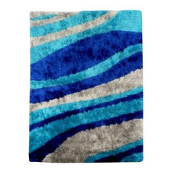 DonnieAnn F653BL Flash Shaggy Area Rug - Blue - The plush body and swirling colors of the DonnieAnn F653BL Flash Shaggy Area Rug - Blue will create an oasis in any room lucky enough to host it. Hand-tufted from 100% polypropylene fibers, this stunning rug features a plush body that's also durable enough for the everyday rigors of high-traffic areas.