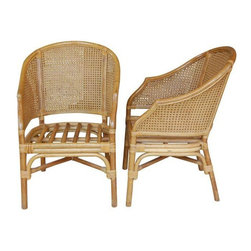 "Pre-owned Vintage Caned Barrel Chairs - A Pair - This is a petite pair of caned rattan barrel chairs. The caning is ""doubled"" or layered making it stronger. The rattan is in very good vintage condition, with some nicks consistent with age, but no issues with the caning or cracking. Cushions come included, however they will require reupholstery.    Measure: 34""H at back; 15.25""H at the seat; 21""W at front; 21.5""D at legs ;23""W overall."