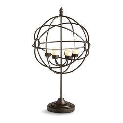 Davinci's Globe Candleholder - It may owe its inspiration to the appointments of country villas that dot the valleys of Naples. The spherical form of DaVinci's Globe Candleholder encircles six votive candles that impart gentle flickers of light that dance along the bronze curvature. A handsome addition to a personal library, eclectic great room, or welcoming foyer.