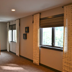 """Midwest Master Suite - Straw shades and linen """"script"""" panels on the windows and rice paper in the glass of the four eight-foot tall sliding doors with disappearing tracks add to the textural interest in the suite."""