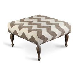 Taupe Zig Zag Ottoman - Sophisticated silhouettes drawn from high-end furniture history define the outlines of the Taupe Zig Zag Ottoman, but the boldness of the upholstery pattern brings this piece expressively into transitional decor, and the neutral palette perfectly bridges any gap between the sturdy weave and the well-turned legs. Just high enough for perching, it's also attractive topped with a tray.