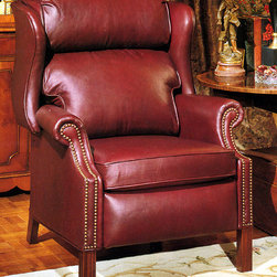 Leather Recliner Chair - This red leather Chippendale leather recliner is large and very comfortable.  This leather recliner chair is used in a study.  Great for reading or recline for further comfort.