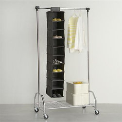 Grey 10-Section Hanging Shoe Bag - Hanging bag stows ten pairs of shoes or miscellaneous accessories in a minimum of closet space. Neutral polyester bag affixes to closet bar with fabric tab fasteners.