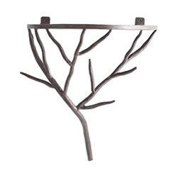 IRON BRANCH BRACKET - Bring a little bit of outside in with this bracket in the shape of tree branches. Rated for up to 25 pounds, this handcrafted beauty can hold up almost anything you want to throw at it. We recommend a pretty vase or a large pillar candle.
