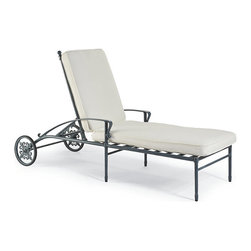 Frontgate - Campaign Outdoor Chaise Lounge with Cushion, Patio Furniture - Solid cast aluminum frame and ornamentation. Hand-applied verde patina finish comes with a three-year warranty. Generously proportioned. Arrives with plush, all-weather back and seat cushions. Cushions are constructed of a high-resiliency foam core with soft polyester wrap. Wile away an afternoon reclining our comfortable Campaign Chaise. This generously sized lounge beautifully showcases cast-iron ornamentation and campaign styling in durable, solid cast aluminum. The frame's strong, linear form is tempered with classic fleur-de-lis and rosette decoration. The look is perfected by our proprietary, 3-step finish, which has the desirable patina of iron that's been aged for 30 years. Part of the Campaign Collection.  .  .  .  .  . Finished with 100% solution dyed Sunbrella fabric covers that resist mold, mildew and fading . Durable wheels offer ease of movement . Moves into seven positions, from upright to fully reclined . Imported.