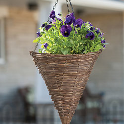 Panacea Products - 12'' Natural Rattan Cone Hanging Basket - Display your gorgeous plants with this hanging basket that offers a sturdy steel construction, a graceful rattan weave and a coco liner for cultivating lush, hearty blooms.   Includes planter and coco liner 12'' W x 13'' H x 12'' D Steel Imported