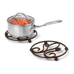 Spectrum Diversified Designs - Patrice Bronze Trivet - Our Patrice Trivet is perfect for protecting countertops and dining tables from hot pans and serving dishes. The raised base ensures that no heat will directly touch your surfaces. Made of sturdy steel and a bronze finish, with a fleur de lis motif.
