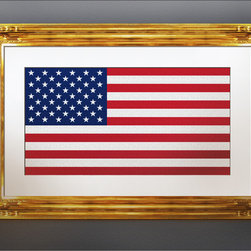 22 k Gold Leaf Framing - We framed and installed this American Flag piece in our client's Orange County home. The 22 k Gold Leaf frame with white linen mat accent pride and honor of our county's freedom.