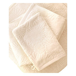 "Hexogonaria Bath Towel - White Sand 30"" x 56"" - Hexagonaria Percarinata, or Petoskey stone, is a fossilized 350 million-year-old coral named after Ottawa Indian Chief Ignatius Petosega, whose name poetically means ""rising sun"" or ""rays of dawn."" These ultra plush bath towels and mits are crafted from 100% organic cotton in a beautiful White Sand hue and exude an opulent feel. Place them thoughtfully in a basket for use in a guest bathroom, or use them everyday and bask in the luxuriousness of Affina."