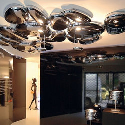 Artemide - Skydro LED Ceiling Lamp by Artemide - Skydro LED Ceiling Lamp by Artemide. Ceiling mounted luminaires for indirect halogen or LED lighting. ABS injection-molded reflective unit; lighting unit in die-cast aluminum; painted steel bearing structure. Available with the integrated halogen or LED lighting unit (electrified) or without (non-electrified).