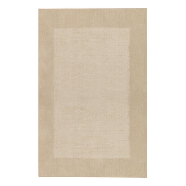 Riverdale rug in Latte - These sturdy, hand loomed area rugs are woven of 100% pure wool and sheared by hand for a smooth - yet durable - surface.  The cut pile border and textured field make a quiet decorative statement, and the array of available color choices help them fit easily into any decor.