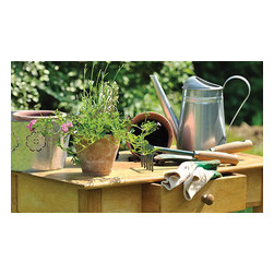 Esschert Design - Printed Doormat - Potting Table - Whether you're a gardener extraordinaire or were born without a green thumb, you can welcome your guests to your home with a tender green scene on your doorstep. This charming rubber doormat is ecofriendly and easy to clean, so feel free to wipe your feet!