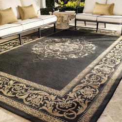 Medallion Outdoor Rug - Sometimes nothing defines a seating area like an area rug. This gorgeous Medallion outdoor rug fits the bill for your porch or patio seating area.