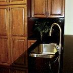 Our Work - Black Galaxy Granite on Schrock cabinets.