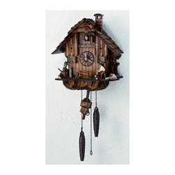 Schneider Cuckoo Clocks - Quartz Black Forest House Handlaid Cuckoo Clock - Two metal weights. Hand carved wooden owl and squirrel. Electronic light sensor for automatic shut-off. Manual shut-off switch on left side of clock. Push button to set strike and time on left side of clock. Time setting knob no move minute hand. Individual hand laid wooden shingles. Moving wood chopper at every full hour. Twelve different melodies. Cuckoo clock with reliable quartz movement, carving, clock case, bird and dial are hand carved wood. Wooden cuckoo, dial with roman numerals and hands. Made from wood. Hand painted flowers finish. Made in Germany. 10.6 in. W x 7.1 in. D x 11.8 in. H (6.2 lbs.). Care Instructions