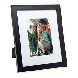 """Philip Whitney - Black Wood Frame With Matting, 4""""x6"""" - Achieve a simple, clean look in your home using this Black Wood Frame. Featuring plain black wood and white matting, this versatile frame can accommodate two different photo sizes. Use a 4-by-6 inch photo with the matting and a 7-by-9 inch photo without it. Sleek and unadorned, this frame works well with both bold and neutral color schemes."""
