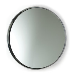 Ollie Polished Aluminum Mirror - Simplicity itself on the wall of an entryway or above a vintage vanity, the Ollie Polished Aluminum Mirror gives a clean, classic freshness to your d�cor.  Perfectly round and simply enclosed in a curved frame of bright metal, this circular wall mirror is a luxury production of a shape made classic by its purity, the mirror clear and lucid within the gleaming ring of the silver metal frame.