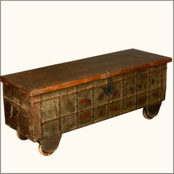 Distressed Reclaimed Wood Treasures Rolling Blanket Storage Chest - You're on a roll with ourDistressed Reclaimed Wood Treasures Rolling Blanket Storage Chest. This handmade multi-purpose storage box can do double duty as a coffee table or wedding chest. You can also easily move it from room to room because it stands on wheels. The lid opens from the back and is attached by three hinges. The entire trunk is built with reclaimed hardwood from Gujarat. We honour and preserve the natural ageing of the wood, no additional paints or stains are added.