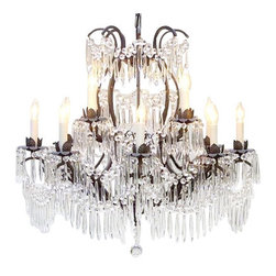 "The Gallery - WROUGHT IRON CRYSTAL CHANDELIER LIGHTING H28"" x W30"" - Great European Tradition. Nothing is quite as elegant as the fine crystal chandeliers that gave sparkle to brilliant evenings at palaces and manor houses across Europe. This beautifully unique version from the Maria Theresa Collection has 100% Crystals that capture and brilliantly reflect the light of the candle bulbs. The frame is all wrought iron, adding the finishing touch to a wonderful fixture. The timeless elegance of this chandelier is sure to lend a special atmosphere anywhere its placed! Please note this item requires assembly. This item comes with 18 inches of chain. 30X28 12 LIGHTS Lightbulbs not included"