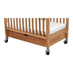 LA Baby - LA Baby Pull Out Drawer for Compact Non-Folding Crib - Natural - WC526-N - Shop for Cribs from Hayneedle.com! Add storage to your nursery with the LA Baby Pull Out Drawer for Compact Non-Folding Crib - Natural. Designed to fit the LA Baby Window Compact Non-Folding Wood Crib with Safety Gate this drawer is the full width of the crib so you have ample storage space for sheets blankets diapers wipes and more! Crafted from solid wood this drawer features sturdy glides and is easy to assemble. About L.A. BabyL.A. Baby is an award-winning division of Amwan a manufacturer and distributor of fine quality juvenile furniture. With products designed for residential and commercial use L.A. Baby items can be found in homes day cares and hotels. Based in City of Industry California L.A. Baby offers a wide range of baby items including cribs strollers safety gates changing pads and high chairs.