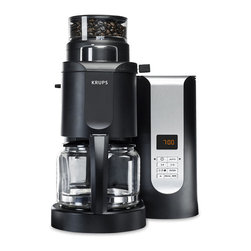 """Frontgate - Krups Grind and Brew Coffee Machine - Conical burr grinder allows for precise grind control. Select from 5 grind settings and 3 brew strength options. Glass carafe has 10-cup capacity. Pause and serve function temporarily halts drip so you can pour a cup of coffee mid-brew. Offset bean hopper and grinder ensure that escaping steam will not clog mechanisms. Get peak flavor with the Krups Grind and Brew Coffee Machine.It precisely grinds your coffee beans just prior to brewing, releasing aromatic oils and ensuring maximum flavor and body. The process is fully automatic, and you can select your preferred grind level and strength for consistent results in every cup. . . . . . Aroma function ensures optimal coffee even when brewing smaller amounts. 43"""" cord; 120V. This item is ineligible for discounts."""