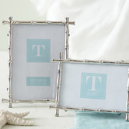 Set of 2 Bamboo Photo Frames - 4 x 6 & 5 x 7 - A sleek, updated feel is conveyed by the Bamboo Photo Frames, which replicate the texture and the delicately interrupted lines of a timeless and exotic decorative material in the bright luxury of silver metal.  Sold as a set of two common sizes, the frames mix the casual with formal for upscale style anywhere from an urban townhouse to a far-off, all-natural vacation home.