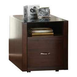 "Steve Silver Furniture - Steve Silver Lamar File Cabinet in Espresso - The sleek, minimalist look of the Lamar Collection is highly versatile, complementing a variety of modern decor styles. The Lamar file cabinet stands 24"" high with a striking 20"" x 32"" glass surface, a storage shelf and one file drawer. Pairs perfectly with the Lamar desk."