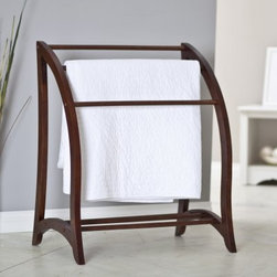 Sara Quilt Rack - What We Like About the Sara Quilt Rack With the freestanding Sara Quilt Rack in your home you'll have an ideal place to store and display your beautiful quilts. Crafted from dependable solid beechwood and featuring three sturdy hanging bars this quilt rack offers plenty of room for your favorite quilts. With its fresh updated design and lovely walnut finish this rack will make a perfect complement to your living room or bedroom decor.About Winsome TradingWinsome Trading has been a manufacturer and distributor of quality products for the home for over 30 years. Specializing in furniture crafted of solid wood Winsome also crafts unique furniture using wrought iron aluminum steel marble and glass. Winsome's home office is located in Woodinville Washington. The company has its own product design and development team offering continuous innovation.