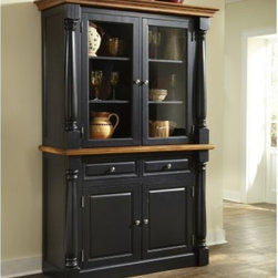 Home Styles Monarch China Cabinet - Black & Oak - You'll have plenty of space for your favorite dishes serving platters and stemware with the Home Styles Monarch China Cabinet - Black & Oak. Perfect for a kitchen or dining room this spacious cabinet consists of a bottom buffet and top hutch with lots of storage options. The buffet contains two felt-lined drawers with dividers to organize silverware and utensils while the two-door cabinet has two adjustable shelves for serving bowls table linens and other items. You can display your favorite dishes behind the glass door cabinets on the hutch which has shelving to accommodate a variety of dining necessities. Made from hardwood solids and engineered wood this china cabinet features a black finish with distressed oak-finished elements for a contrasting design. Picture frame moldings solid wood pilasters with intricate carved detail crown moldings and brushed nickel hardware complete the warm elegant style. About Home StylesHome Styles is a manufacturer and distributor of RTA (ready to assemble) furniture perfectly suited to today's lifestyles. Blending attractive design with modern functionality their furniture collections span many styles from timeless traditional to cutting-edge contemporary. The great difference between Home Styles and many other RTA furniture manufacturers is that Home Styles pieces feature hardwood construction and quality hardware that stand up to years of use. When shopping for convenient durable items for the home look to Home Styles. You'll appreciate the value.