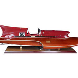 "Thunderboat Hydroplane - The thunderboat hydroplane measures 31.5 x 11.75 x 9"". It features a leather seat, an inlaid wood deck  a detailed original dash. The Jaguar XK120 ruled the road; Doris Day and Cary Grant were Oscar nominated. It was a time of peace, and optimism was unbridled. It was then that Rivas roared across the Lago di Como and skimmed the Mediterranean waves off St. Tropez. Thunderboats (also called Hydroplanes) racing with each other at record speed. Stateside, the luxurious Chris Crafts were de rigeur with Hollywood elite. The throaty growl of that big engine built inside gleaming mahogany, rich leather, chrome trim. Leather padded seats displayed movie stars trying out the new bikini fashions. Husband number 3, 4, or 5 behind the wheel, decked out in spotless captain's finery. No Coast Guard was able to overtake these sleek twin-engine torpedo shaped racers. The curves, the looks, the excitement, the opulence!"
