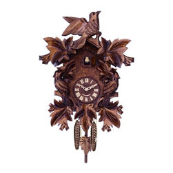 River City Cuckoo Clocks - Cuckoo Clock with Seven Hand-Carved Maple Leaves and Three Birds - This traditionally styled German quartz cuckoo clock features wooden hands, a wood dial with Roman numerals, and a warm light yellow hand-painted and hand-carved cuckoo bird. The cuckoo clock case features seven hand-carved maple leaves and three birds.  Two cast iron pine cone weights are suspended beneath the clock case by two seperate brass chains.    -The hand-carved pendulum continously swings back and forth.  On every hour the cuckoo bird emerges from a swinging door above the clock dial and counts the hour by cuckooing once per hour. (Example: At one o'clock the bird will cuckoo once. At eight o'clock the bird will cuckoo eight times) The half hour is announced with one cuckoo call.   - Great effort has been made to portray each cuckoo clock as accurately as possible. As with many handmade items, the exact coloration and carving may vary slightly from clock to clock. We consider this to be a special part of their character.   - This clock is covered by a two year limited warranty covering workmanship and manufacturers defects. River City Cuckoo Clocks - 807-16Q