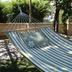 Magnolia Casual Hammocks - Magnolia Casual Summer Stripe Fabric Hammock - SP127SL - Shop for Hammocks from Hayneedle.com! Additional features Overall hammock length: 13 ft. 6 in. Optional pillow measures 19W x 24L inches Pillow has 2 ties for attaching to hammock Pillow insert is 100% polyester Zipper closure on pillow for easy removal Pillow cover is machine washable Hammock features 100% polyester ropes Sundure fabric feels like cotton but is more resilient Wood spreader bar is attached to extra thick rope strings Hammock includes a matching storage sleeve with shoulder strap Hanging hardware sold separately The Summer Stripe Fabric Hammock features refreshing and calm green and white stripes for a summer-time appeal that looks great anywhere. This single layer fabric hammock has the beneficial look and feel of cotton though it is actually constructed of sundure polyester threads which make it more breathable than quilted hammocks. Its polyester material is also weather- mildew- and fade-resistant. The rope strings are longer at the center of the hammock creating a slightly cupped surface that is harder to tip. Choose between several pillow options. Go pillow-less and enjoy the comfort of the hammock by itself or choose between two pillows. The Palm Pillow features a white background with a green tropical palms pattern and the Summer Toile Green pillow features a green background with a white pattern of flowers and vines. About Magnolia Casual HammocksMagnolia Casual sweeps you off your feet and into the relaxation zone by offering a wide variety of hammocks and swings along with complementary comfortable pillows manufactured from fade- and mildew-resistant polyester that holds up well to outdoor use. Based in Pascagoula Miss. Magnolia Casual's Sundure Fabrics are colorful and the hammocks and swings are built for durability and years of enjoyment. The company also offers shower and hamper curtains that will brighten your home.
