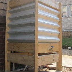RainCRATE - The RainCRATE provides a unique enclosure for a 55gal rain barrel for the collection, storage, and distribution of rain water for your garden or landscape. Available as pictured in treated lumber or in reclaimed wood / cedar.