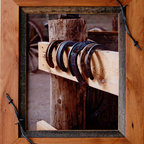 MyBarnwoodFrames - Western Frames-8x10 Wood Frame with Barbed Wire Sagebrush Series  Size - Western  Frames-8x10  Wood  Frame  with  Barbed  Wire  -  Sagebrush  Series          ---  Rustic  Frames  handcrafted  from  natural  hardwood  and  accented  with  a  1/2  inch  reclaimed  barnwood  inset  and  a  barbed  wire  overlay.  This  rustic  wood  frame  is  stained  light  walnut  color  and  is  perfect  for  framing  photos  and  art.  Each  8x10  picture  frame  will  accommodate  one  8x10  inch  photo  or  print  and  can  be  hung  horizontally  or  vertically.  The  frame  includes  glass  and  hanging  hardware.  Cleans  with  a  soft  cloth.  Backing  is  included  and  is  secured  with  flexible  push  points  so  inserting  your  own  photos  is  simple.  We  craft  each  of  our  country  frames  to  withstand  generations  of  use.  Corners  are  glued  and  secured  with  a  screw  so  they  won't  separate.  Each  of  these  country  frames  makes  a  great  gift.  A  rustic  frame  perfect  for  multiple  decor  styles.                     Product  Specifications:                   Finished  Dimensions:  11.5H  x  13.5W  x  .75D              Includes  glass  and  hanging  hardware              Can  be  hung  horizontally  or  vertically                               Please  Note:   Your  purchase  includes  a  frame,  glass,  and  hardware  for  hanging.   Photos  are  NOT  included.