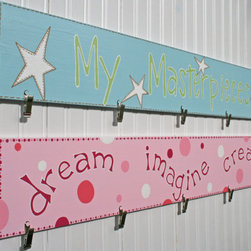 Custom Artwork Hanger By dreaminggiggles - I love this customized art hanger. The artist will create a design that the parent chooses and hand-paints it in acrylic paint. A gloss varnish finishes the piece and the artist will even add hints of extra-fine glitter if desired. The display is made of pine wood. The clips have duckbill jaws which are non-marking.