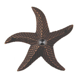 Waterwood - Brass Starfish Doorbell in Oil Rubbed Bronze - The Waterwood Starfish doorbell creates a seaside motif at your door. Displaying this doorbell will help you project a spirit of relaxed living from the front door of your home. This solid brass doorbell is crafted using the sand casting technique. It is then hand finished and coated with a protective laquer to withstand the elements. Waterwood doorbells are easy to install and will add personality to your home. It comes with a lighted push button and mounting screws.