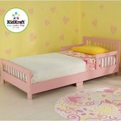KidKraft Slatted Toddler Bed - Pink - Your daughter will love having her very own bed especially when it looks like the KidKraft Slatted Toddler Bed - Pink. This bright pink toddler bed helps make the transition from a crib to a regular bed as easy as possible thanks to a low profile and protective bed rails. Crafted of sturdy solid wood this bed features additional support in the middle of the frame for added durability. It fits most crib mattresses. Detailed assembly instructions are included. Dimensions: 51.57L x 28.27W x 18.15H inches.About KidKraftKidKraft is a leading creator manufacturer and distributor of children's furniture toy gift and room accessory items. KidKraft's headquarters in Dallas Texas serves as the nerve center for the company's design operations and distribution networks. With the company mission emphasizing quality design dependability and competitive pricing KidKraft has consistently experienced double-digit growth. It's a name parents can trust for high-quality safe innovative children's toys and furniture.