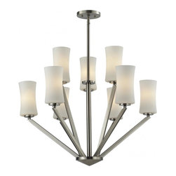 Nine Light Brushed Nickel Matte Opal Glass Drum Shade Chandelier - This nine light chandelier uses exquisitely designed, angled brushed nickel arms to hold uniquely shaped, warm glowing matte opal shades. An exceptionally contemporary fixture, this fixture includes adjustable rods to ensure the perfect hanging height.