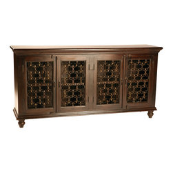 Dovetail Furniture - Santa Fe Sideboard - Constructed from Indian hardwood and hand forged iron, the Sante Fe Sideboard has an elegant and classic style that will transform your decor. Whether in the entryway, dining room, great room, or office, this sideboard adds an element of discernment to your design. A striking crown moulding resides above four beautifully decorated doors. Each section within the cabinet has a single shelf for a variety of storage options. Below the doors lies another moulding element that mirrors the top. Turned legs and vintage style hardware complete the overall design while the espresso sealed finish adds the right touch of timeless elegance. One can imagine a framed mirror hung above the sideboard or perhaps a porcelain vase with a floral arrangement. In any case we think the Santa Fe Sideboard will be the perfect addition to your living space.