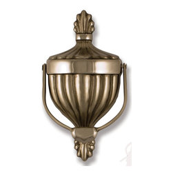 Michael Healy - Michael Healy Victorian Urn Door Knocker X-3951HM - The Victorian Urn Door Knocker is sand-cast in soild Nickel Silver & Polished Chrome. Nickel Silver is an alloy that has a warm silver color which is attained by adding nickel to bronze. Michael combines a high polished finish with brushed accents to generate a contemporary look. A stainless steel brush on a high speed lathe is used to create the brushed effects. The mirrored finish of polished nickel silver is achieved through varying degrees of sanding and buffing. Michael uses these techniques to highlight or accent the raised areas on a piece. The Victorian Urn Door Knocker was designed by Michael Healy, an accomplished Rhode Island artisan. One of the most popular of door knocker designs, the elegant Victorian Urn has graced the entrances of countless homes and estates. The Victorian Urn has been created with a stylish flourish at the top and base of the Door Knocker. This design extends throughout the entire piece. This traditional design with an updated twist will be a welcome enhancement to the entrance of any home. Hand crafted. Mounting hardware included.
