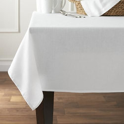 "Abode 60""x120"" Tablecloth - The perfect foundation for any table, our classic white tablecloth is woven for us in Portugal of 100% cotton, pre-washed for extra softness."