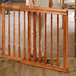 Evenflo - Safety Home Decor Swing Gate - Baby proofing just got easier! Give yourself peace of mind with the Home Decor Swing Gate. The classic design compliments any home decor. The one-hand latch release offers added convenience while keeping your baby safe. This gate can be used in openings, at the top of stairs, and other irregular openings. Features: -Hardware mounted for added security.-Swing mount swings both ways or use One-Direction Swing setting for top of stairs.-For use with children 6 to 24 months.-Collection: Safety Gate.-Distressed: No.Dimensions: -Adjusts to fit openings 31'' to 52'' wide, 32'' high.-32'' H x 31-52'' W.