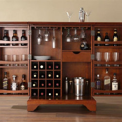 "Crosley Furniture - LaFayette Bar Cabinet in Cherry - Beautiful Raised Panel Doors. Antique Brass Finish Hardware. Plenty of Room for Storing Barware & Spirits. Doubles as a Serving Station when Entertaining. Adjustable Levelers in Legs. Expands to 62 1/2"" Wide when Open. Solid Hardwood & Veneer Construction. Front & back of bar have matching finish. Assembly required. Allen Key and Philips Head screw driver will be required for assembling this bar. 42in. H x 31.25in. W x 22in. D (150 lbs)Constructed of solid hardwood and wood veneers, this Expandable Bar Cabinet is designed for longevity. The beautiful raised panel doors provide the ultimate in style to dress up your home. The doors open and top folds out to double the size of your entertaining / serving area. Inside the doors, you will find plentiful storage space for spirits, glassware, and a host of other bar items. The center cabinet features 16 bottle wine storage, utility drawer, hanging stemware storage, and extra space for a variety of other barware."