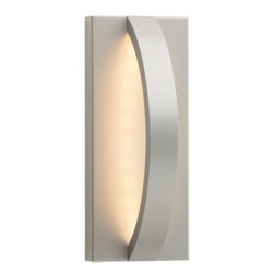 LBL Lighting - Hunter Outdoor Wall Sconce by LBL Lighting - A simple curve with impactful style. The LBL Lighting Hunter Outdoor Wall Sconce is modeled after the arc of a hunter's bow, with clean, smooth lines concealing an LED light array behind an acrylic diffuser. Light bounces off the metal wall plate's matte finish, offering subtle indirect illumination. Mount horizontally or vertically to suit any outdoor design scheme. For more than 40 years, Illinois-based LBL Lighting has created innovative lighting fixtures based on the principles of beauty, originality and quality. Such values remain evident in their current line of fixtures, which feature distinctive elements like organic art glass, solid construction and the latest low voltage and LED lighting technology.