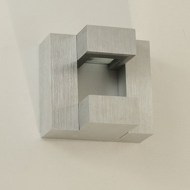 Stream Wall Sconce by Edge Lighting - Stream wall sconce features a unique geometric design with a solid satin aluminum finish and glass lens.