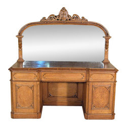 Antiques - Antique English Solid Golden Oak Victorian Gothic Buffet Sideboard Server - Country of Origin: England Circa: 1860 Victorian & Gothic Solid Golden Oak Mahogany Large Mirror Carved Gothic Accents 4 Drawers  Dovetail Joinery 1 Cellarette Paneled Surfaces Top Quality! Strong & SturdyThis is a gorgeous antique English solid golden oak Victorian Gothic pedestal buffet sideboard server. It features a very unique and gorgeous large mirror on its back which has a beautiful carved frame adorned with Gothic carved accents and a distinguished pierced pediment with a carved shield and scrolls. The mirror may show some aged flaws but they only validate its antiquity and add character to the furniture. This buffet offers three smooth operating drawers, one that is well constructed with dovetail joinery and they have unique paneled surfaces with attractive Gothic designs. In addition there are two cabinets that have one shelf, one open drawer that has two height adjustments and a large cellarette  that has a traditional handle. The doors are made of mahogany and oak and they have elegant paneled surfaces with attractive Gothic decorations. Their doors tend to stay slightly open but as seen in the pictures they're easily overlooked. This piece may have minor age appropriate flaws and wood imperfections, but considering its age, circa 1860, it is overall in very good cosmetic and structural condition and it is strong and sturdy. This is a gorgeous piece of furniture that will not only enrich your home decor with its presence but will also become a treasured heirloom in your family!