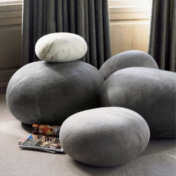 Felted Wool Stones - These giant felt pebble poufs are so fun and architectural.