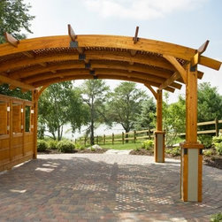 "Sonoma Arched Wood Pergola - 16 x 16 ft. - If an outdoor wedding has always been your dream the Sonoma Arched Wood Pergola - 16 x 16 ft. can help make it a reality. The wood pergola is made from durable Douglas fir in a redwood or a mocha finish. Every piece of the pergola is dip-stained and precision-cut for guaranteed quality. Enjoy protection from the wind and the sun in exquisite comfort. The pergola includes an anchor system and is ready to assemble. Dimensions: 192L x 192W x 117.7H inches. Spruce up your outdoor setting a little more with the help of the Wall Kit for Sierra 10 x 10 ft. Pergola. Compatible with the beautiful Sierra Pergola this wall kit is made from the same durable Douglas fir in either a mocha or redwood finish. The kit is dip-stained and precision-cut for guaranteed quality. The features of this kit include two wall supports and three panes with fixed windows offering privacy and protection from the wind. Includes assembly hardware. Dimensions: 108.7L x 5W x 70H inches. About Outdoor GreatRoom CompanyWith over 50 patents to its name the Outdoor GreatRoom Company is one of the most innovative names in gas fireplaces and outdoor design period. Since 1975 Dan Ron Steve and Ger have produced a yard of amazing products like the Heat-N-Glo that have changed the industry. In fact they want to change the way you think about your backyard or patio. It's about bringing the luxury and comfort of the living room outside to make an """"Outdoor Room."""" They want you to literally think outside the box. To make that beautiful concept a reality Outdoor GreatRoom designs manufactures and sells pergolas outdoor kitchens grills outdoor furniture fireplaces fire pits lighting and heating products. There's no better name in outdoor leisure than this fine Minnesotan company."
